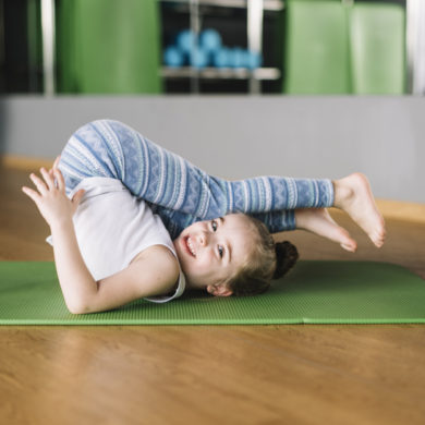 happy-girl-child-practicing-yoga-mat-looking-camera_23-2148185923 (1)